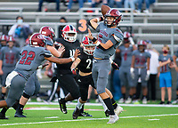 Landon Phipps (5) of Springdale<br />passes the ball with Aiden Robinson (29)<br />of Farmington coming up from behind to apply pressure at Cardinals Stadium, Farmington, Arkansas on Friday, September 11, 2020 / Special to NWA Democrat-Gazette/ David Beach