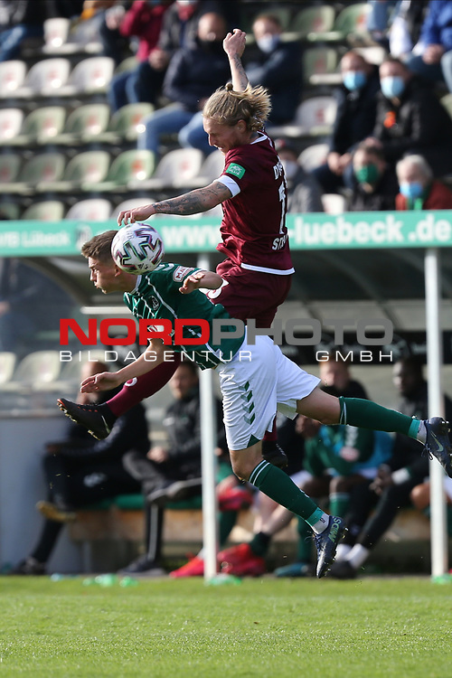 17.10.2020, Dietmar-Scholze-Stadion an der Lohmuehle, Luebeck, GER, 3. Liga, VfB Luebeck vs SG Dynamo Dresden <br /> <br /> im Bild / picture shows <br /> Thorben Deters (VfB Luebeck)  m Zweikampf gegen Marvin Stefaniak (SG Dynamo Dresden)  <br /> <br /> DFB REGULATIONS PROHIBIT ANY USE OF PHOTOGRAPHS AS IMAGE SEQUENCES AND/OR QUASI-VIDEO.<br /> <br /> Foto © nordphoto / Tauchnitz