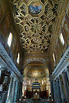 The coffered ceiling designed by Domenichino in the 17th century and the 13th century mosaics by Pietro Cavallini in the apse of the Basilica di Santa Maria in Trastevere in the Trastevere district of Rome.