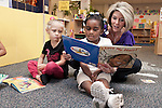 September 14, 2011. Raleigh, NC. . Kim Jackson, the head teacher for the class, reads to (left to right) Ava Pearce and Mia Cofield.. Project Enlightenment, a public pre-kindergarten program for at risk children, has been threatened with closure due to state wide budget cuts..
