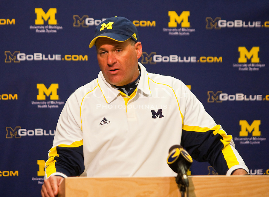 Michigan head coach Rich Rodriguez answers questions from the media at a press conference after the Wolverines' spring football game, Saturday, April 17, 2010, in Ann Arbor, Mich. (AP Photo/Tony Ding)