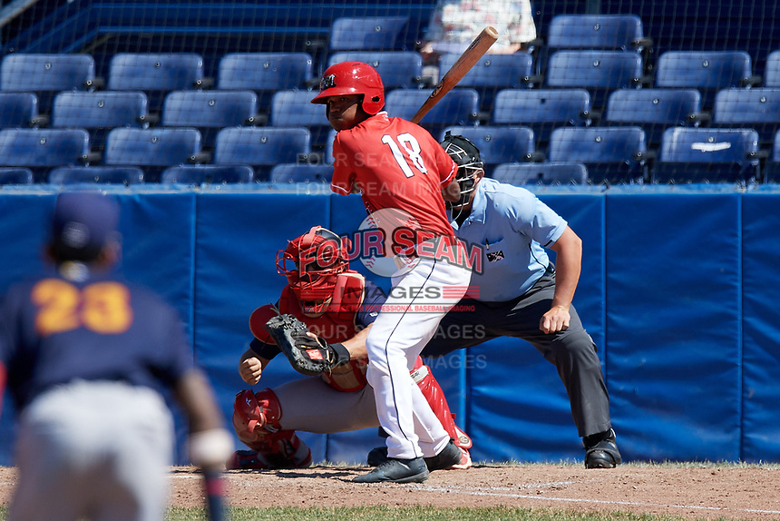 Batavia Muckdogs center fielder Brayan Hernandez (18) at bat in front of catcher Joe Gomez (25) and umpire Jordan Sandberg during a game against the State College Spikes on July 8, 2018 at Dwyer Stadium in Batavia, New York.  Batavia defeated State College 8-3.  (Mike Janes/Four Seam Images)