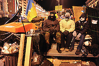 Group of young nationalists on the barricades. After the violent event when crowd on Independence Square in Kiev was dispersed and more than 30 students were badly hurt, many people expressed their wish to be guards of barricades during nights.