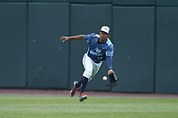 West Michigan Whitecaps center fielder Jose Azocar (18) attempts to catch a sinking line-drive during the game against the South Bend Cubs at Fifth Third Ballpark on June 10, 2018 in Comstock Park, Michigan. The Cubs defeated the Whitecaps 5-4.  (Brian Westerholt/Four Seam Images)