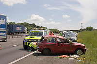 Highways Agency officers assist a car that rolled onto the embankment M40. This image may only be used to portray the subject in a positive manner..©shoutpictures.com..john@shoutpictures.com