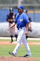 GCL Blue Jays pitching coach Willie Collazo (17) walks to the mound during a game against the GCL Yankees 2 on July 2, 2014 at the Bobby Mattick Complex in Dunedin, Florida.  GCL Yankees 2 defeated GCL Blue Jays 9-6.  (Mike Janes/Four Seam Images)