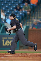 Home plate umpire Jennifer Pawol hustles into position to make a call during the South Atlantic League game between the Hickory Crawdads and the Ocelotes de Greensboro at First National Bank Field on June 11, 2019 in Greensboro, North Carolina. The Crawdads defeated the Ocelotes 2-1. (Brian Westerholt/Four Seam Images)