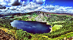 Lough Tay or The Guinness Lake, is a small but scenic lake set on private property in the Wicklow Mountains in Ireland.