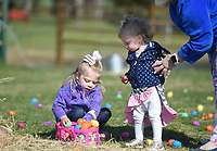 Adley Combs, 3, of Bentonville (from left) and Hollyn Combs, 1, collect Easter eggs, Friday, April 2, 2021 at 10107 Andy Buck Road in Pea Ridge. No Limit Pediatric Therapies held its first special needs friendly Easter egg hunt in celebration of World Autism Awareness Day. Check out nwaonline.com/210403Daily/ for today's photo gallery. <br /> (NWA Democrat-Gazette/Charlie Kaijo)