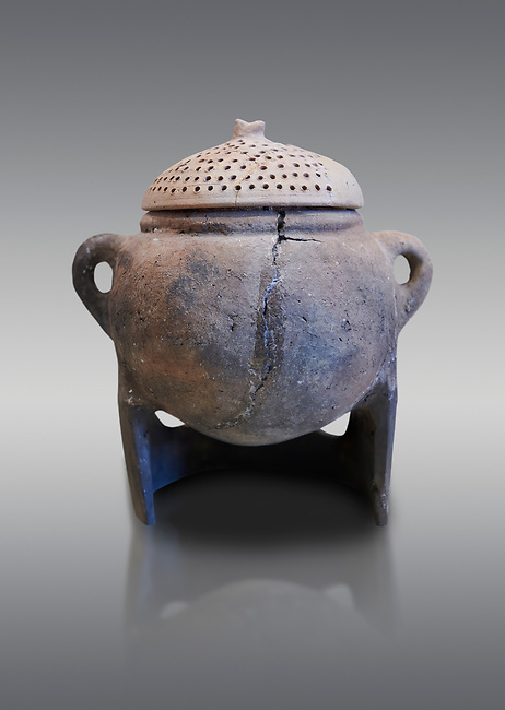 Hittite terra cotta cooking pot with perforated lid on a charcoal burner pot stand. Hittite Empire, Alaca Hoyuk, 1450 - 1200 BC. Çorum Archaeological Museum, Corum, Turkey
