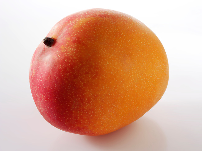 Fresh whole mango against white to cut out