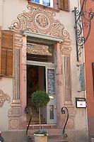 wrought iron sign entrance door wistub du sommelier bergheim alsace france