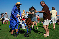 """Eighty-six years young, Elizabeth """"Grandma Liz"""" Acles dances to the sounds of  Theo and the Zydeco Patrol  as the 2008 Concerts on the Green series began on Sunday, July 20 at Kate Sessions Park in Pacific Beach.  The series will continue for three more weeks on every Sunday between 4pm and 6:30pm."""