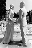 """Italy. Tuscany. Florence. Cemetery """" Cimiterio monumentale di San Miniato al Monte"""". Marble statues of a couple. A man and a woman. Florence is the capital city of the Italian region of Tuscany and of the province of Florence. It is the most populous city in Tuscany, with approximately 370,000 inhabitants, expanding to over 1.5 million in the metropolitan area. © 1993 Didier Ruef"""