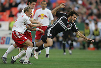 April 2, 2006: Washington, DC: DC United midfielder (14) Ben Olsen is fouled by New York Red Bulls midfielder (19) Chris Henderson at RFK Stadium.  The game ended in a tie, 2-2.