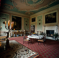 Large paintings are mounted in stucco frames and ornate, delicate, stucco-work covers the walls and ceiling of the Eating Room at Osterley Park