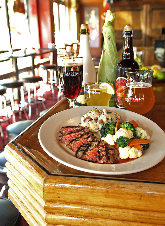 Drunken flank steak, garlic mashed potatoes and honey steamed mixed vegetables is a highlight of The Muddy Pig menu. Wash it all down with over 70 bottled beers or 20 offerings from the tap. Photo by Brad Stauffer