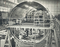 Workmen on two levels carry out individual tasks on two levels in a section of TriStar that is in a much earlier stage of assembly than Air Canada's aircraft. Though the TriStar is put together at Palmdale, 1,500 subcontractors, including five Canadian firms are busy making individual parts for the plane.<br /> <br /> Photo : Boris Spremo - Toronto Star archives - AQP