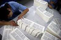 """Amity Printing Company employees check the quality of printed Bible pages in the Amity Printing Company's new printing facility in Nanjing, China....On May 18, 2008, the Amity Printing Company in Nanjing, Jiangsu Province, China, inaugurated its new printing facility in southern Nanjing.  The facility doubles the printing capacity of the company, now up to 12 million Bibles produced in a year, making Amity Printing Company the largest producer of Bibles in the world.  The company, in cooperation with the international organization the United Bible Societies, produces Bibles for both domestic Chinese use and international distribution.  The company's Bibles are printed in Chinese and many other languages.  Within China, the Bibles are distributed both to registered and unregistered Christians who worship in illegal """"house churches."""""""