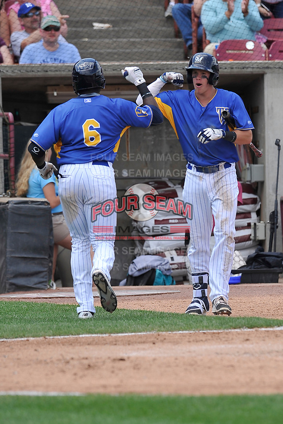 Wisconsin Timber Rattlers second baseman Tucker Neuhaus (19) congratulates Demi Orimoloye (6) on his home run during a game against the Quad Cities River Bandits at Fox Cities Stadium on June 27, 2017 in Appleton, Wisconsin.  Wisconsin lost 6-5.  (Dennis Hubbard/Four Seam Images)