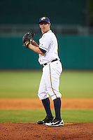 Montgomery Biscuits pitcher Kyle Winkler (8) gets ready to deliver a pitch during a game against the Tennessee Smokies on May 25, 2015 at Riverwalk Stadium in Montgomery, Alabama.  Tennessee defeated Montgomery 6-3 as the game was called after eight innings due to rain.  (Mike Janes/Four Seam Images)