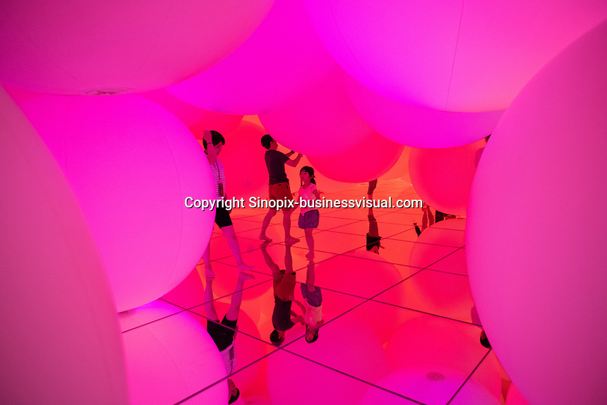 """""""Expanding Three-Dimensional Existence in Transforming Space"""" is  a collection of large ballons that float and cjhange color creating an everchanging exhibit in Team Lab Planets, Tokyo, Japan, July-2019."""