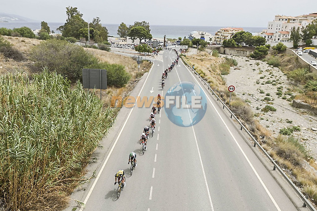 The peloton strung out during Stage 10 of La Vuelta d'Espana 2021, running 189km from Roquetas de Mar to Rincón de la Victoria, Spain. 24th August 2021.     <br /> Picture: Charly Lopez/Unipublic | Cyclefile<br /> <br /> All photos usage must carry mandatory copyright credit (© Cyclefile | Unipublic/Charly Lopez)