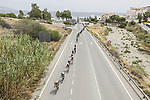 The peloton strung out during Stage 10 of La Vuelta d'Espana 2021, running 189km from Roquetas de Mar to Rincón de la Victoria, Spain. 24th August 2021.     <br /> Picture: Charly Lopez/Unipublic   Cyclefile<br /> <br /> All photos usage must carry mandatory copyright credit (© Cyclefile   Unipublic/Charly Lopez)