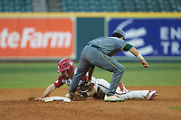Ricky Martinez (11) of the Baylor Bears applies a tag to Braydon Webb (8) of the Arkansas Razorbacks as he tries to steal second base during game nine of the 2020 Shriners Hospitals for Children College Classic at Minute Maid Park on March 1, 2020 in Houston, Texas. The Bears defeated the Razorbacks 3-2. (Brian Westerholt/Four Seam Images)