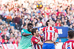 Samuel Umiti of Futbol Club Barcelona competes for the ball with Diego Godin and Vrsaljko of Atletico de Madrid  during the match of Spanish La Liga between Atletico de Madrid and Futbol Club Barcelona at Vicente Calderon Stadium in Madrid, Spain. February 26, 2017. (ALTERPHOTOS)