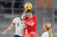 ORLANDO CITY, FL - FEBRUARY 18: Julie Ertz #8 of the United States and Jessie Fleming #17 of Canada battle for a ball during a game between Canada and USWNT at Exploria Stadium on February 18, 2021 in Orlando City, Florida.