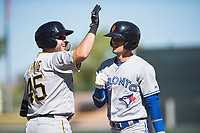 Surprise Saguaros first baseman Will Craig (45), of the Pittsburgh Pirates organization, congratulates Cavan Biggio (26), of the Toronto Blue Jays organization, after Biggio's first home run of the season during an Arizona Fall League game against the Scottsdale Scorpions at Scottsdale Stadium on October 26, 2018 in Scottsdale, Arizona. Surprise defeated Scottsdale 3-1. (Zachary Lucy/Four Seam Images)
