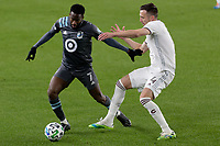 ST PAUL, MN - OCTOBER 28: Kevin Molino #7 of Minnesota United FC and Danny Wilson #4 of Colorado Rapids  battle for the ball during a game between Colorado Rapids and Minnesota United FC at Allianz Field on October 28, 2020 in St Paul, Minnesota.