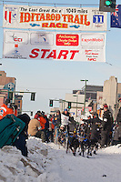 Musher Magnus Kaltenborn and Iditarider Anna Arnn leave the 2011 Iditarod ceremonial start line in downtown Anchorage, Alaska