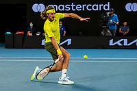 9th February 2021, Melbourne, Victoria, Australia; Stefanos Tsitsipas of Greece returns the ball during round 1 of the 2021 Australian Open on February 9 2020, at Melbourne Park in Melbourne, Australia.