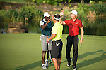 Dwight Yorke (in blue), Li Haotong of China (in red), and Zhao Hongbo (in green) rejoice  during the World Celebrity Pro-Am 2016 Mission Hills China Golf Tournament on 23 October 2016, in Haikou, Hainan province, China. Photo by Marcio Machado / Power Sport Images