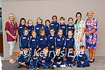 Teachers Sheila Goulding (back right) and Miriam Dennehy with Mary Sugrue SNA (back left) and the Junior Infants of St  Olivers NS Killarney on Wednesday (school doesn't have permission to print kids names)
