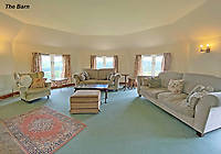 BNPS.co.uk (01202 558833)<br /> Pic: LillicrapChilcott/BNPS<br /> <br /> Pictured: The barn sitting room.<br /> <br /> A sprawling waterfront estate that has been in the same family for half a century is on the market for £2.25m.<br /> <br /> Bellscat Farmhouse is a pretty Grade II listed home with beautiful far-reaching views over Fowey River in Cornwall.<br /> <br /> The grand four-bedroom home looks a far cry from a typical farmhouse and is believed to have been two farm cottages that were converted into one home.<br /> <br /> There is also a separate two-bedroom barn and the properties sit in 37 acres of undulating land, creating a private and scenic estate.