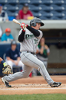 Dayton Dragons first baseman James Vasquez (25) follows through on his swing against the West Michigan Whitecaps on April 24, 2016 at Fifth Third Ballpark in Comstock, Michigan. Dayton defeated West Michigan 4-3. (Andrew Woolley/Four Seam Images)