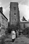 The Wicken Love Feast, takes place on Ascension Day and celebrates the joining together of two parishes in 1587. Wicken Northamptonshire 1970s Uk.  The congregation walk from the church to the Gospel Oak for a short open air service. (Not sure here it may be an Elm)