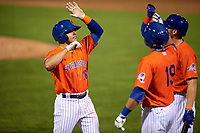Syracuse Mets Danny Espinosa (18) high fives Travis Taijeron (19) and Brandon Nimmo (23) after hitting a home run during an International League game against the Charlotte Knights on June 11, 2019 at NBT Bank Stadium in Syracuse, New York.  Syracuse defeated Charlotte 15-8.  (Mike Janes/Four Seam Images)