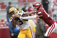 LSU running back Tyrion Davis-Price (3) completes a pass as Arkansas defensive back Hudson Clark (17) covers, Saturday, November 21, 2020 during the fourth quarter of a football game at Donald W. Reynolds Razorback Stadium in Fayetteville. Check out nwaonline.com/201122Daily/ for today's photo gallery. <br /> (NWA Democrat-Gazette/Charlie Kaijo)