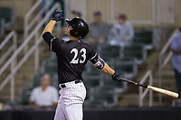 Gavin Sheets (23) of the Kannapolis Intimidators follows through on a solo home run against the Greensboro Grasshoppers at Kannapolis Intimidators Stadium on September 8, 2017 in Kannapolis, North Carolina.  The Intimidators defeated the Grasshoppers to sweep the South Atlantic League Northern Division playoffs in two games.  (Brian Westerholt/Four Seam Images)