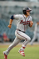 Catcher Logan Brown (99) of the Rome Braves runs out a batted ball in a game against the Columbia Fireflies on Tuesday, June 4, 2019, at Segra Park in Columbia, South Carolina. Columbia won, 3-2. (Tom Priddy/Four Seam Images)