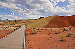 Long boardwalk into Painted Cove.  The Painted Hills division of John Day Fossile Beds National Monument contains not just stunningingly beautiful landscapes and interesting geologic history, but also tranquil peace and quiet.  Please contact the photographer regarding licensing this image.