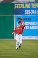Batavia Muckdogs Peyton Burdick (7) catches a fly ball during a NY-Penn League game against the Auburn Doubledays on June 14, 2019 at Dwyer Stadium in Batavia, New York.  Batavia defeated 2-0.  (Mike Janes/Four Seam Images)