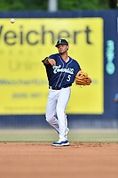 Asheville Tourists second baseman Coco Montes (5) warms up between innings during a game against the West Virginia Power at McCormick Field on May 30, 2019 in Asheville, North Carolina. The  Power defeated the Tourists 8-3. (Tony Farlow/Four Seam Images)