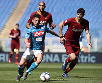 Football, Serie A: AS Roma - SSC Napoli, Olympic stadium, Rome, March 31, 2019. <br /> Napoli's Dries Mertens (l) in action with Roma's Federico Fazio (r) and Steven Nzonzi (c) during the Italian Serie A football match between Roma and Napoli at Olympic stadium in Rome, on March 31, 2019.<br /> UPDATE IMAGES PRESS/Isabella Bonotto
