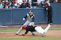 Jake Mayers #12 of the Hillsboro Hops tags Brenden Kalfus #7 of the Vancouver Canadians out at third base during a game at Nat Bailey Stadium on July 24, 2014 in Vancouver, British Columbia. Vancouver defeated Hillsboro, 5-2. (Larry Goren/Four Seam Images)