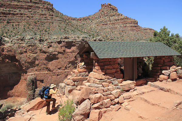 Hiker at 3 mile rest area on Bright Angel Trail, above Indian Gardens and ascending to the South Rim, Grand Canyon National Park, Arizona. . John offers private photo tours in Grand Canyon National Park and throughout Arizona, Utah and Colorado. Year-round.